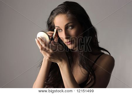 daily care: a woman applying make up