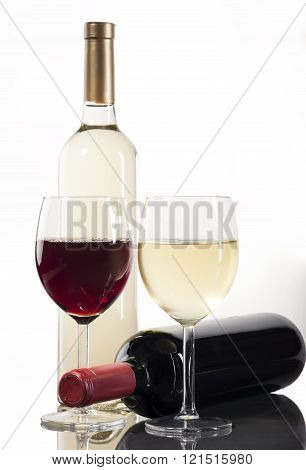 Red and white wine bottles and glasses on white background