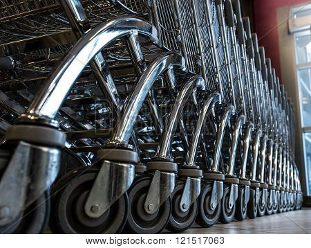 Close-up View Of A Row Of Stacked Supermarket Trolleys