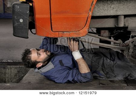 auto mechanic repairing a vehicle