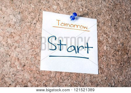 Start Reminder For Tomorrow On Paper Pinned On Cork Board