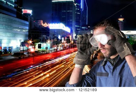Worker on a city scape background