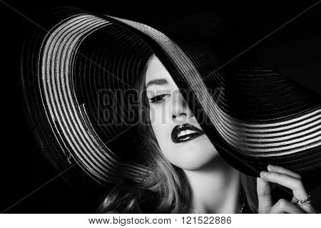 Portrait Of Elegant Woman In Black And White Hat.