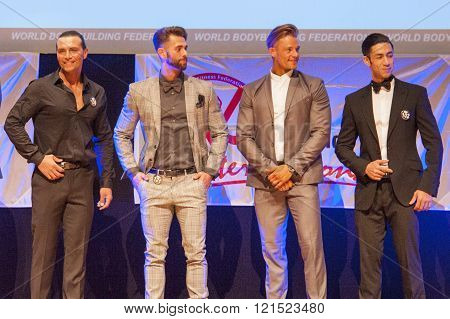 Male Physique Models Show Their Best In Suit On Stage