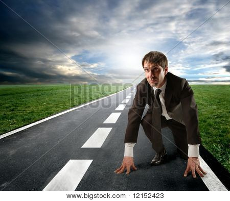 competition concept: business man starting a running
