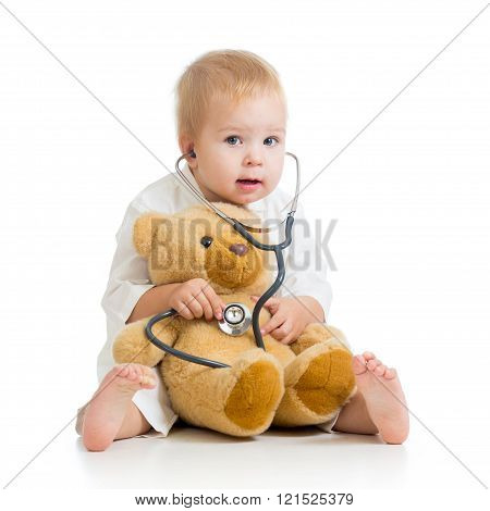 kid playing a doctor isolated on white