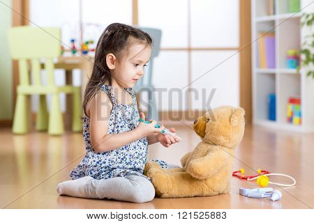 kid playing a doctor in children room