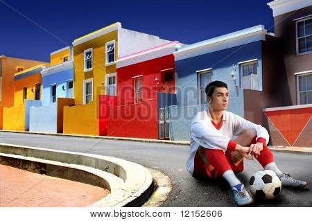 soccer player in a colorful street