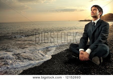 business man relaxing in an enchanting seascape