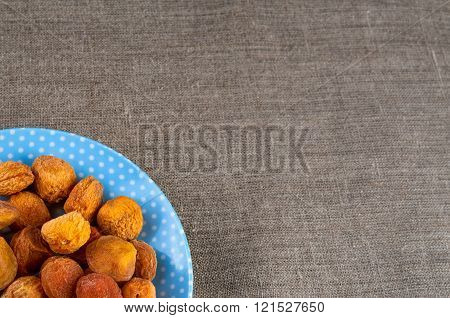 Top view of dried apricots heap on plate