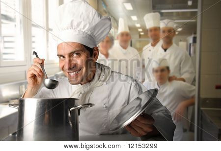 group of cooks in a restaurant kitchen
