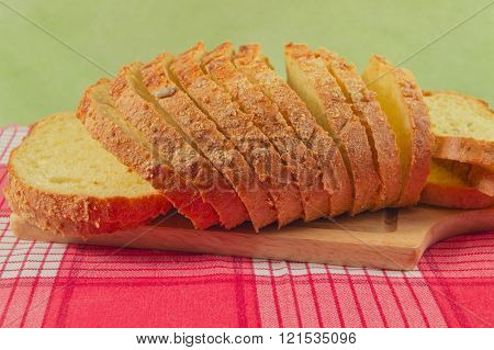 Sliced Wholewheat Bread On A Red Napkin