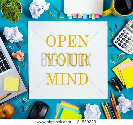 Open your mind. Office table desk with supplies, white blank note pad, cup, pen, pc, crumpled paper,