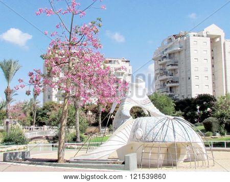 Playground near modern white buildings in quarter Neve Savyon in Or Yehuda Israel