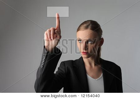 business woman pressing a digital button