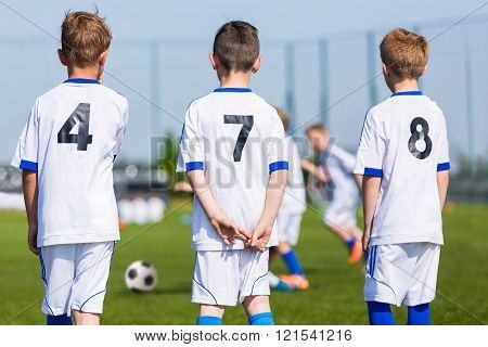 Youth Soccer Team; Reserve Players On A Bench; Boys Ready To Play European Football Match.