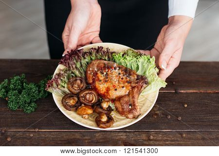 Food decorating. Grilled pork on wooden table