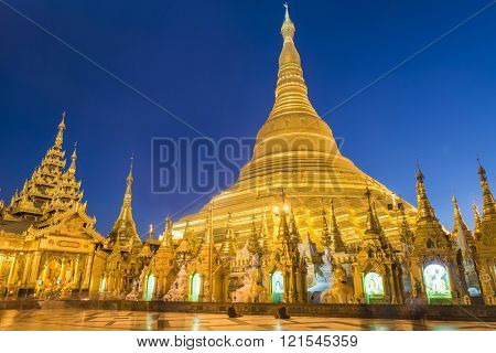 Shwedagon Paya is the most sacred golden buddhist pagoda in Myanmar. Yangon, Myanmar. Evening photo