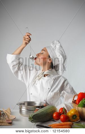 female cook sampling genuine food