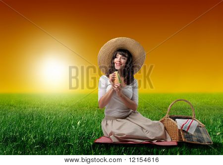 beautiful lady doing a picnic on a grass field