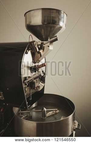 Best professional coffee roasting machine filled with beans and ready to work Side view