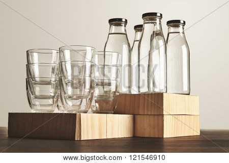 Set Glasses And Bottles With Water On Wooden Table