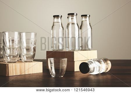 Closeup Set Glasses Bottles Water On Wooden Table
