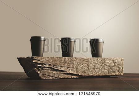 Three Paper Cups Isolated On Wooden Brick