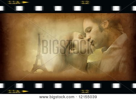 couple kissing with tour eiffel on old movie frame
