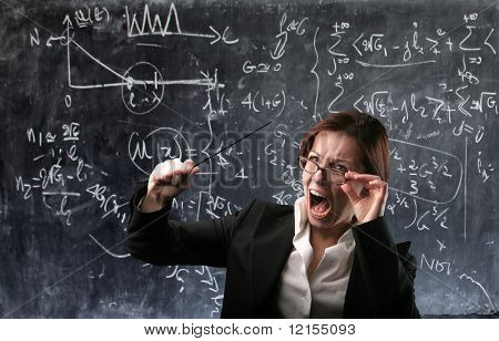 angry teacher with blackboard on the background