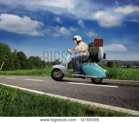 girl driving old moped with suitcase on country road