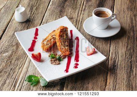 Vegetarian dessert.  Carrot apple roll  and coffee