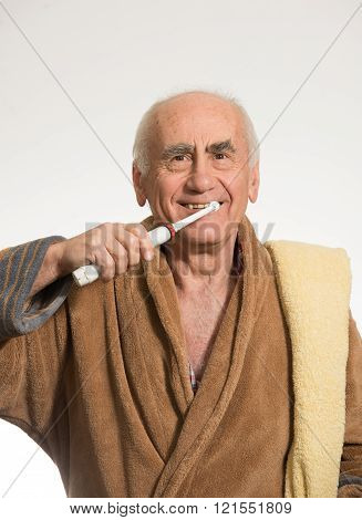 old man brushing his teeth
