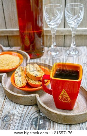 Dessert sweet liqueur wine cup with espresso coffee and amandel cantuccini on rustic wooden backgound