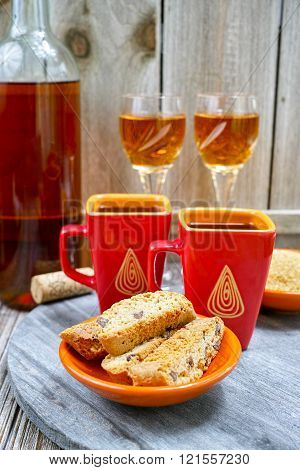 Dessert sweet liqueur wine two cups with espresso coffee and amandel cantuccini on rustic wooden backgound