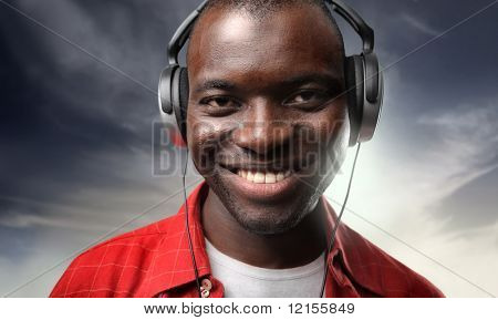 cheerful black guy listening music
