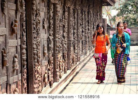 Mandalay Myanmar - March 15 2015: Girls in Golden Shwenandaw Kyaung temple in Mandalay.