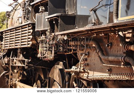 Old steam locomotive with detail and close up of huge parts. ** Note: Soft Focus at 100%, best at smaller sizes