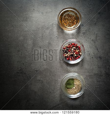 Three Glass Bowls With Herbs And Spices