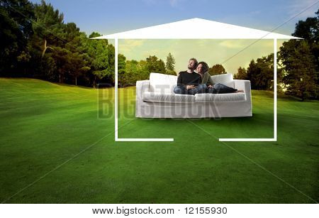 young couple on a sofa in a beautiful natural landscape surrounded by home drawing