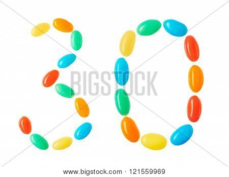 30 Number Made Of Multicolored Candies Isolated On White