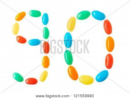 90 Number Made Of Multicolored Candies Isolated On White