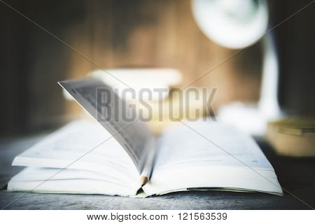 Open Book With Pencil