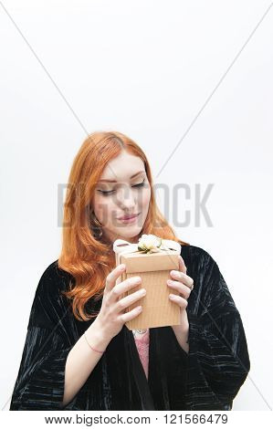 Young Redhead Woman  With Gift Box