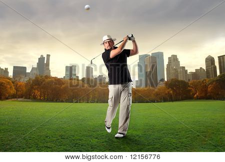 golf player shooting a ball at central park