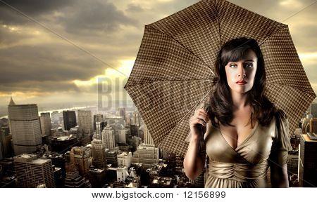 attractive sad woman with umbrella and cityscape