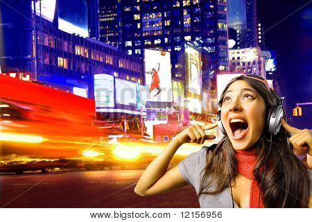 girl with headphones in a city street