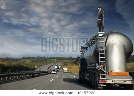businessman standing on oil track