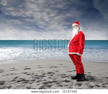 funny santa standing on beach