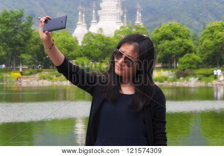 Chinese Woman Taking Selfies